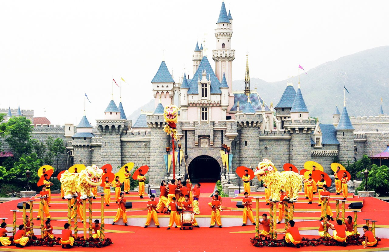 HONG KONG, CHINA: A traditional dragon is performed during the opening ceremony of Hong Kong Disneyland theme park, 12 September 2005. Disney officially opened its newest theme park in Hong Kong by Chinese Vice President Zeng Qinghong, marking its first step into the lucrative China market. AFP PHOTO/TED ALJIBE (Photo credit should read TED ALJIBE/AFP/Getty Images)